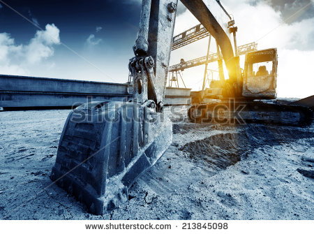 stock-photo-big-excavator-on-new-construction-site-in-the-background-the-blue-sky-and-sun-213845098