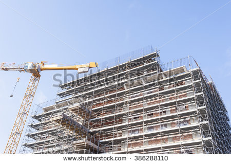 stock-photo-construction-scaffolding-of-a-building-under-construction-and-a-crane-386288110