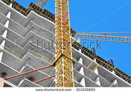 stock-photo-crane-and-building-construction-site-against-blue-sky-301229885